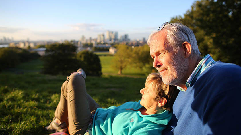 3431_Older couple in park with London in background-Aviva_image