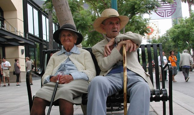 SeniorCouple_sitting_on_public_bench-Freeimages-small