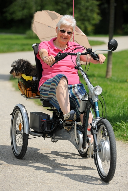 older woman on tricycle
